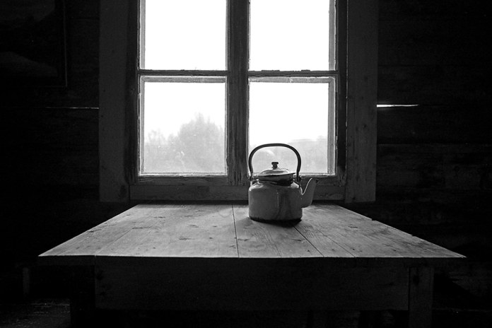 Norway, Leica M6, ILFORD FP4+ - When I was in Norway, I visited a slate producer and his factory. I really loved this makeshift cabin we had coffee in. This was just taken while I kept warm.