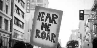 Hear me roar - Women's March, Los Angeles. Canon EOS-3, Fujifilm Acros 100