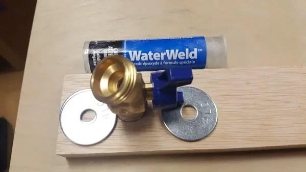 Building a semi-automatic film processor - installing the drain faucet