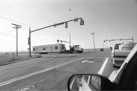 Moving house - Traffic stands still as a large trailer is moved at the intersection of 95th Street and Hwy 52, Boulder CO, July 2017 (Nikon F100, 20mm, Ilford HP5 Plus) - Kenneth Wajda Photographer