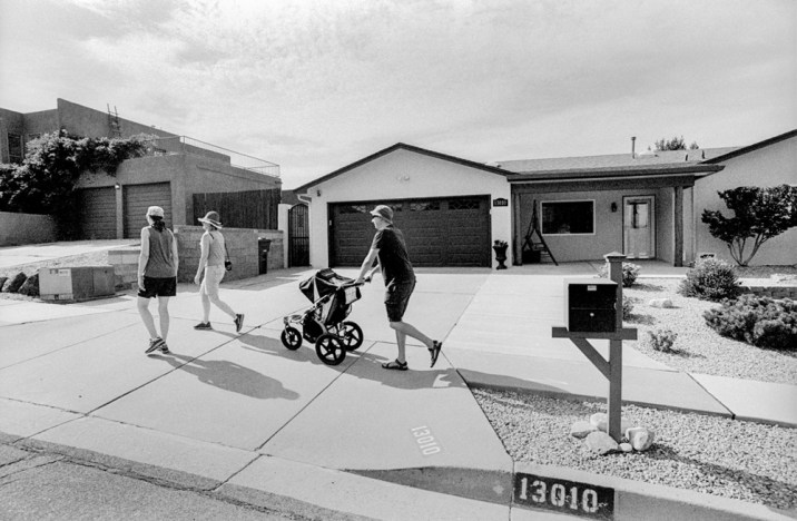 Stoller stroll - A family takes a walk in their suburban neighborhood, Albuquerque NM, August 2017 (Nikon F100, 20mm, ILFORD HP5 Plus) - Kenneth Wajda Photographer