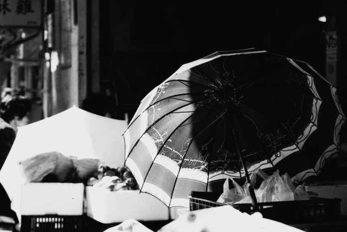 Under cover - Shot onKodak EASTMAN DOUBLE-X 5222at EI 1600. Black and white negative film in 35mm format. Push processed 2+2/3 stops.