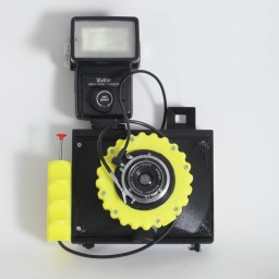CAMERADACTYL OG 4x5 in yellow with flash