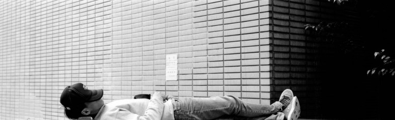 Off the job - Shot on ILFORD FP4 PLUS at EI 800. Black and white negative film in wide 35mm format (TEXPan). Push processed 2⅔-stops. Fuji GW690III + EBC Fujinon 90mm f/3.5.