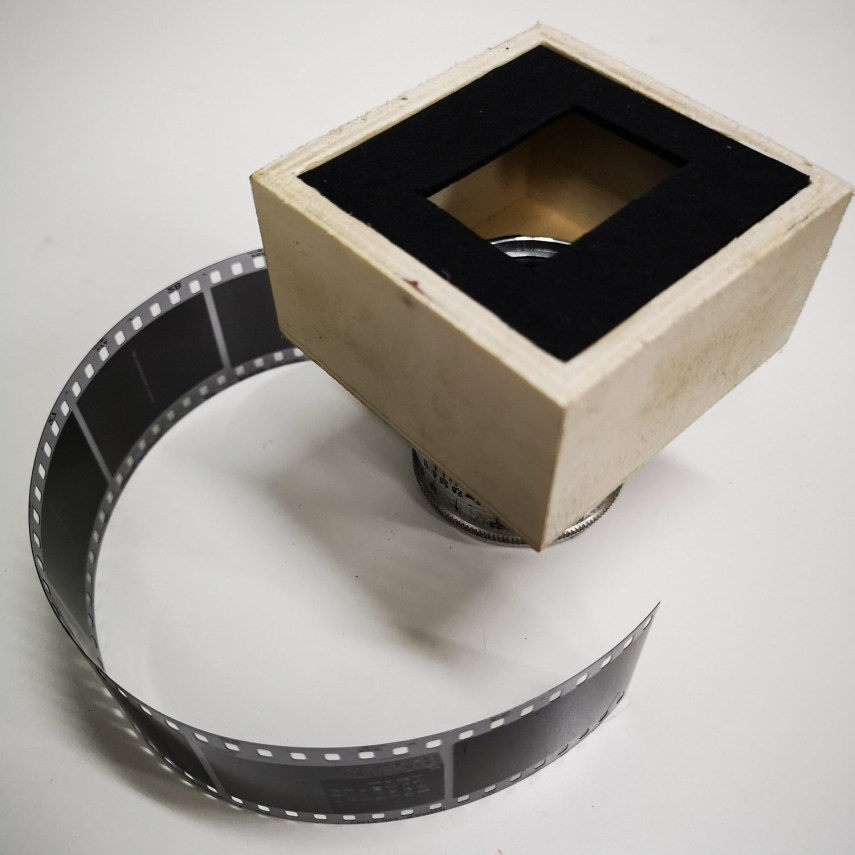 Focusing unit, bottom half (lens and film mask in place)