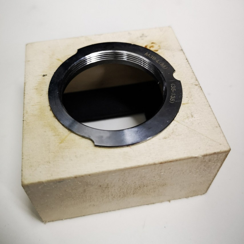 L39 thread mount adapter set into unpainted enlarger focusing unit