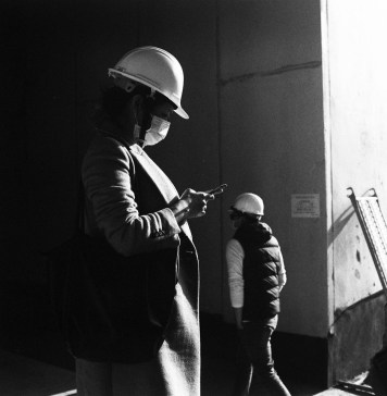 On the job - shot on ILFORD Delta 400 at EI 25600. Black and white negative film in 120 format shot as 6x6. Push processed 6-stops.