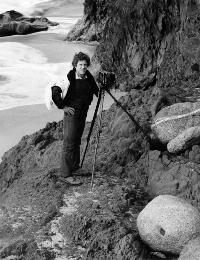 Older Kim Weston with camera