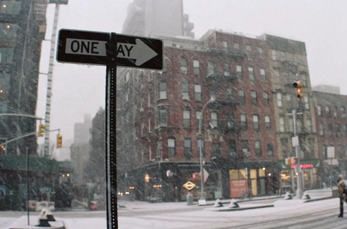 Canon Elan 7 with Pentax 6x7 35mm Fisheye lens. Kodak Portra 160. Snapshot in a snowstorm on Houston St. in New York City.