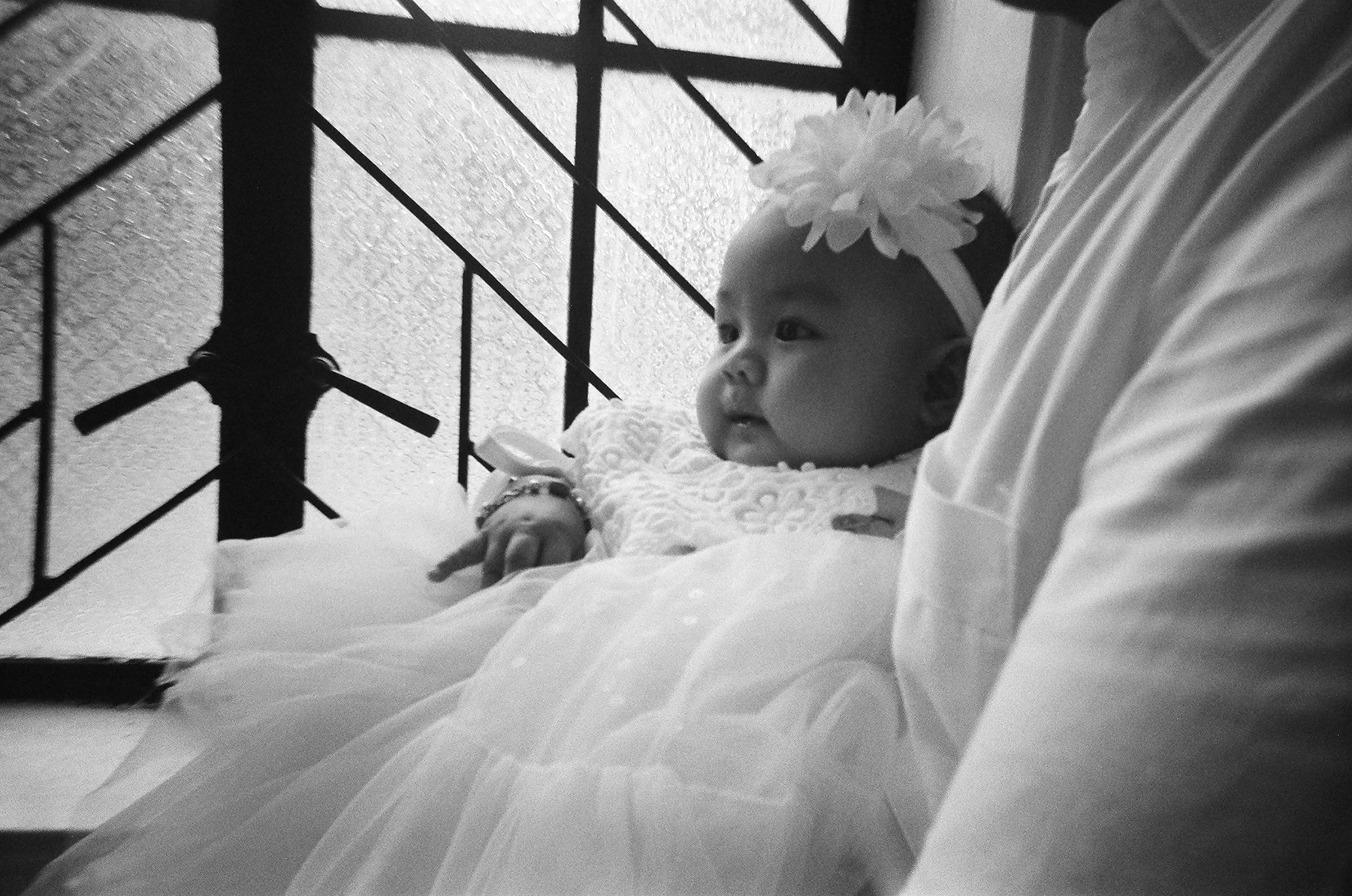 Francesca Eloise, daughter of Francis Perez on her baptism - Kentmere 400 + HARMAN REUSABLE CAMERA