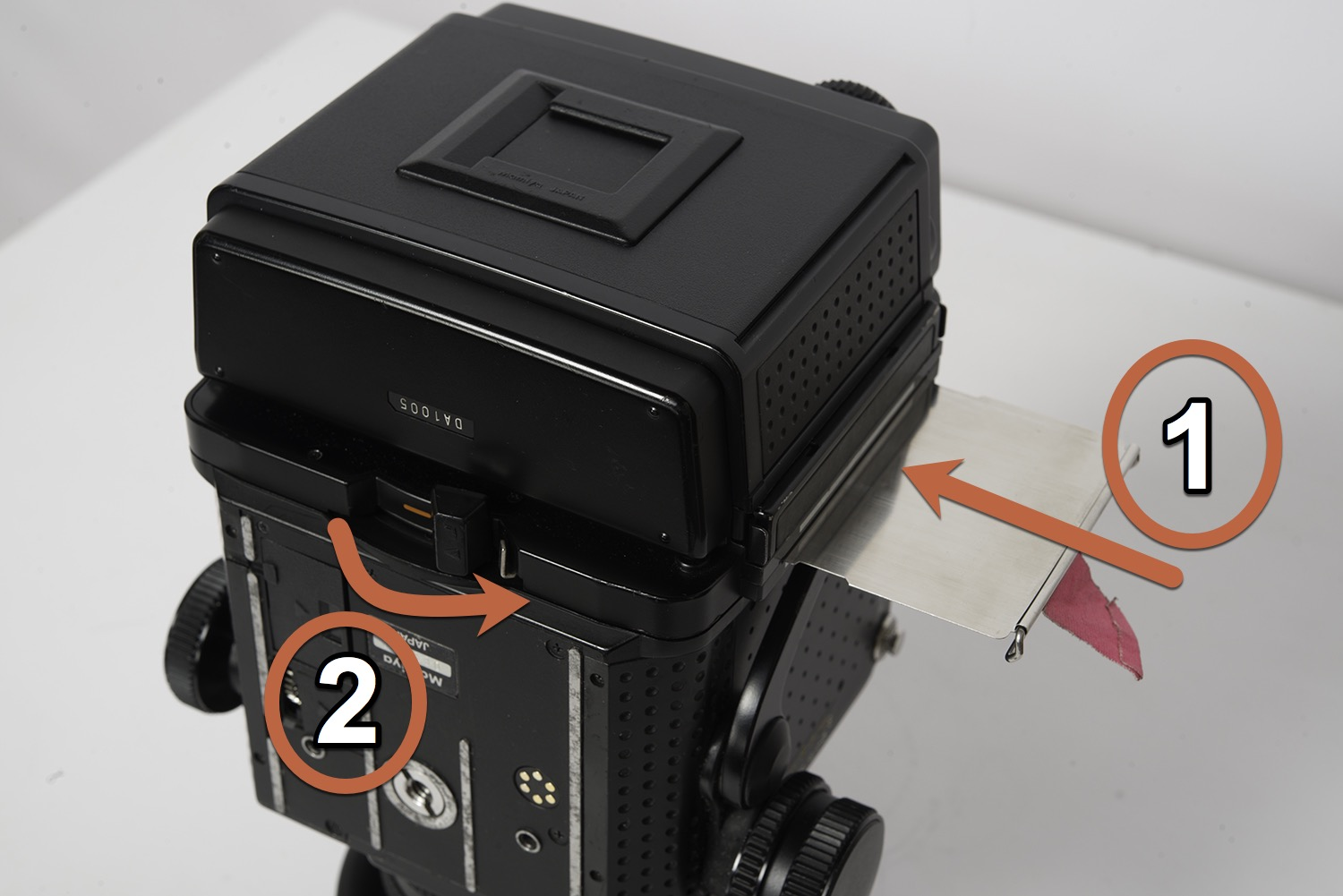 Step 1: insert the dark slide.  Step 2: move the film holder lock to the right.