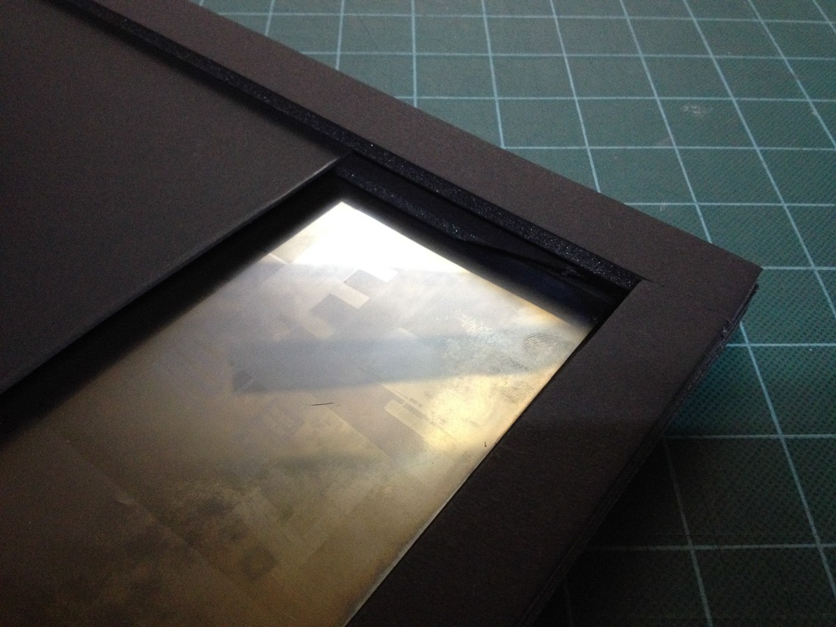 "Detail of one-sided proof-of-concept 8x20"" film holder with a silvered negative inside to test fitting of real film."