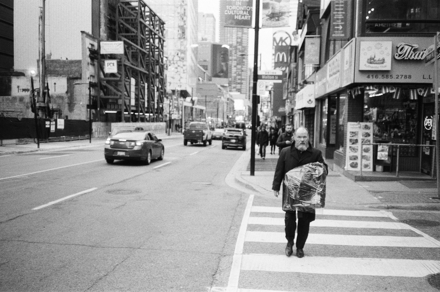Man with Drycleaning - Fomapan 200 Creative and Olympus XA