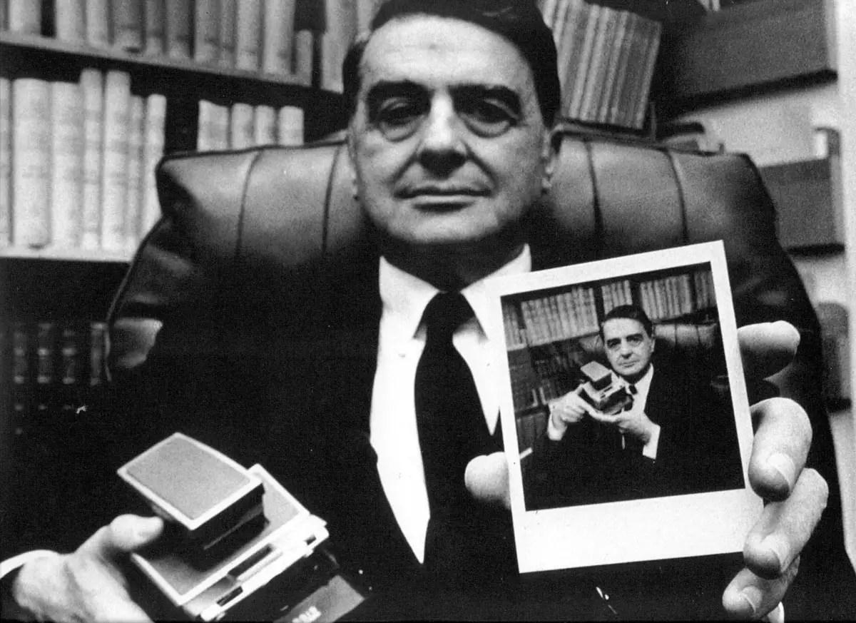 Edwin H Land with a Polaroid SX-70