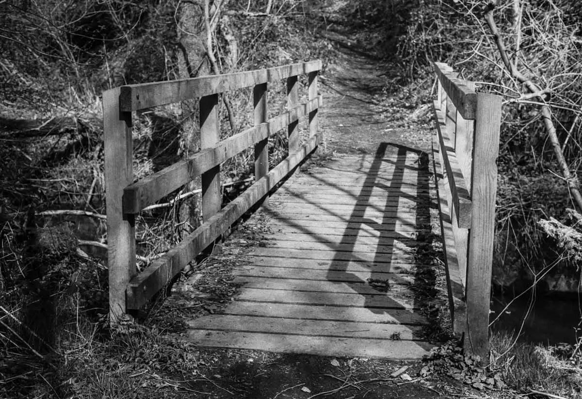 A bridge to trip-trap across - ILFORD HP5 PLUS, Minolta SRT 101b, MD Rokkor 50mm f/1.7 - Nigel Fishwick