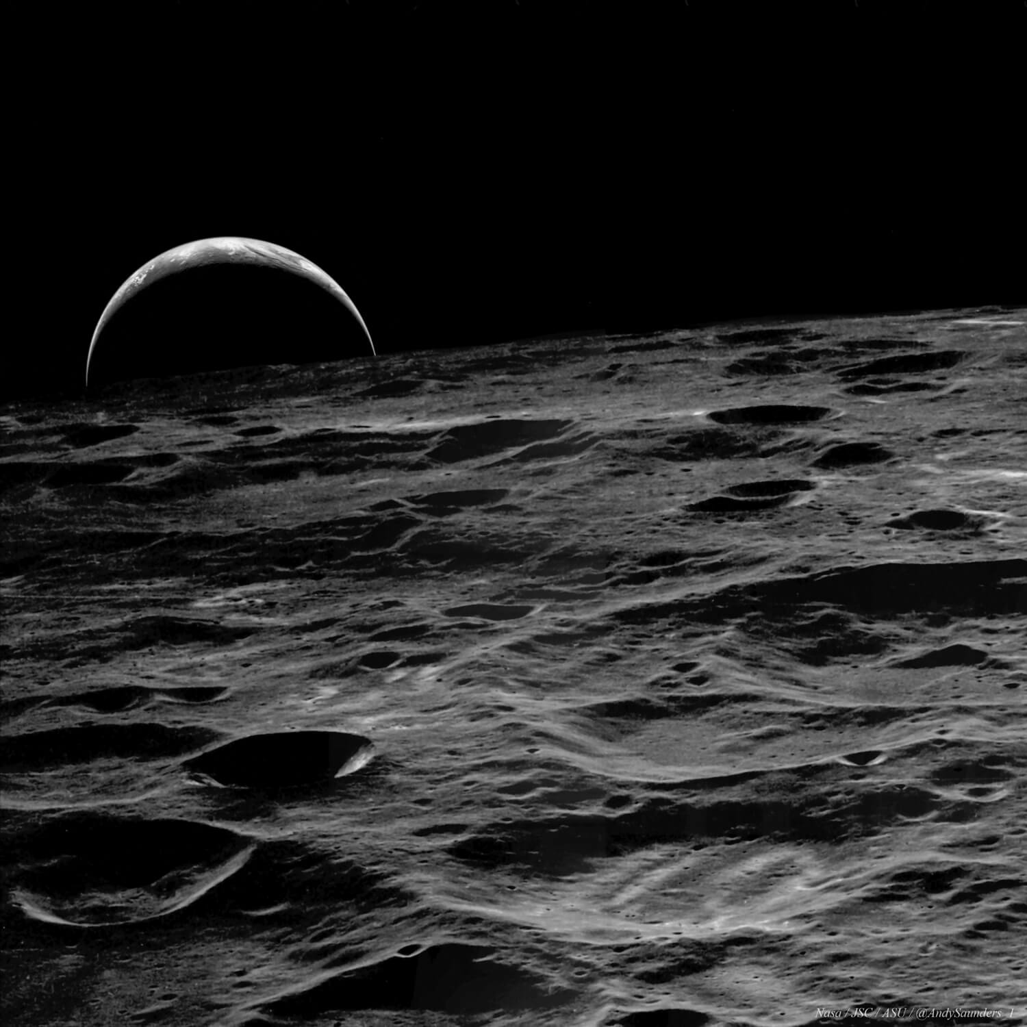The sun-lit crescent Earth rises above the stark, cratered lunar far side on Apollo 14, 1971.
