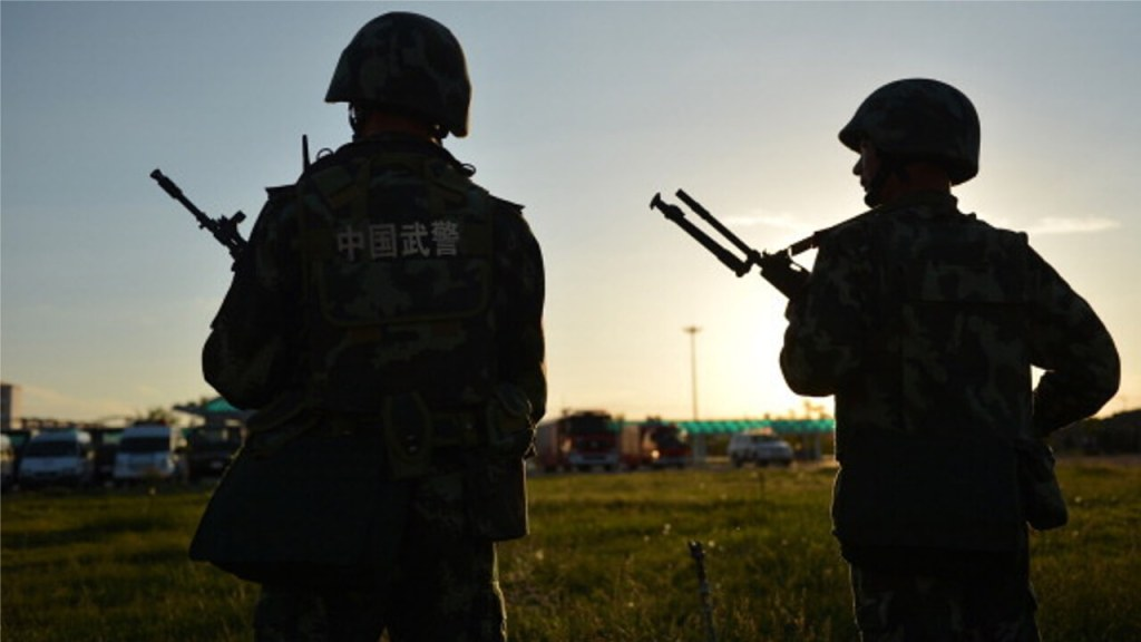 Staff Member of a Xinjiang Camp
