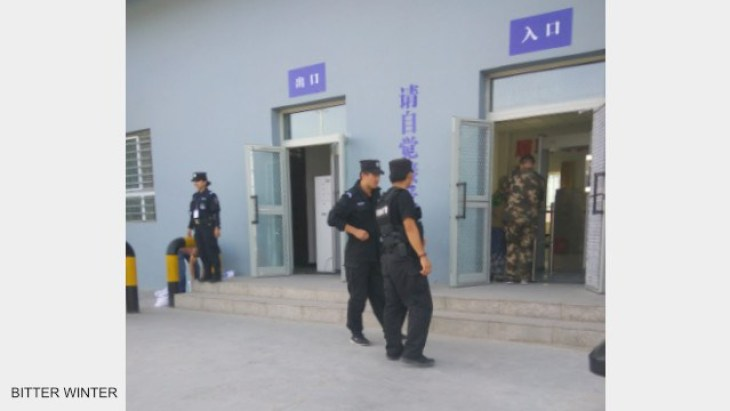 Police patrol and stand guard outside the transformation through education camp.