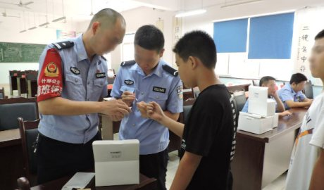 Public security bureau officers in Sichuan's Shifang city collect middle school students' DNA samples.