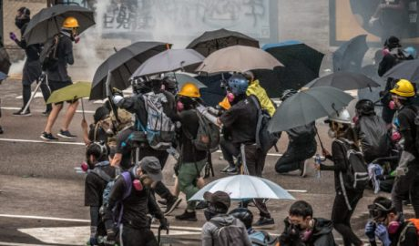 Hong Kong protestors and reporters need face masks and umbrellas to withstand tear gas attacks by the police.