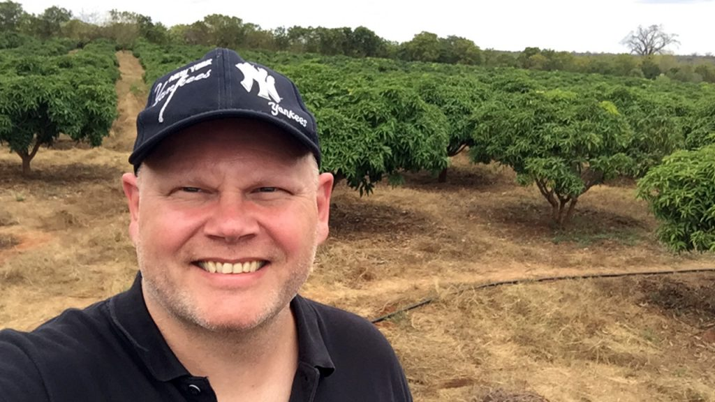Johan, a customer from Stockholm, in front of the Mango trees in Kibwezi, 180630