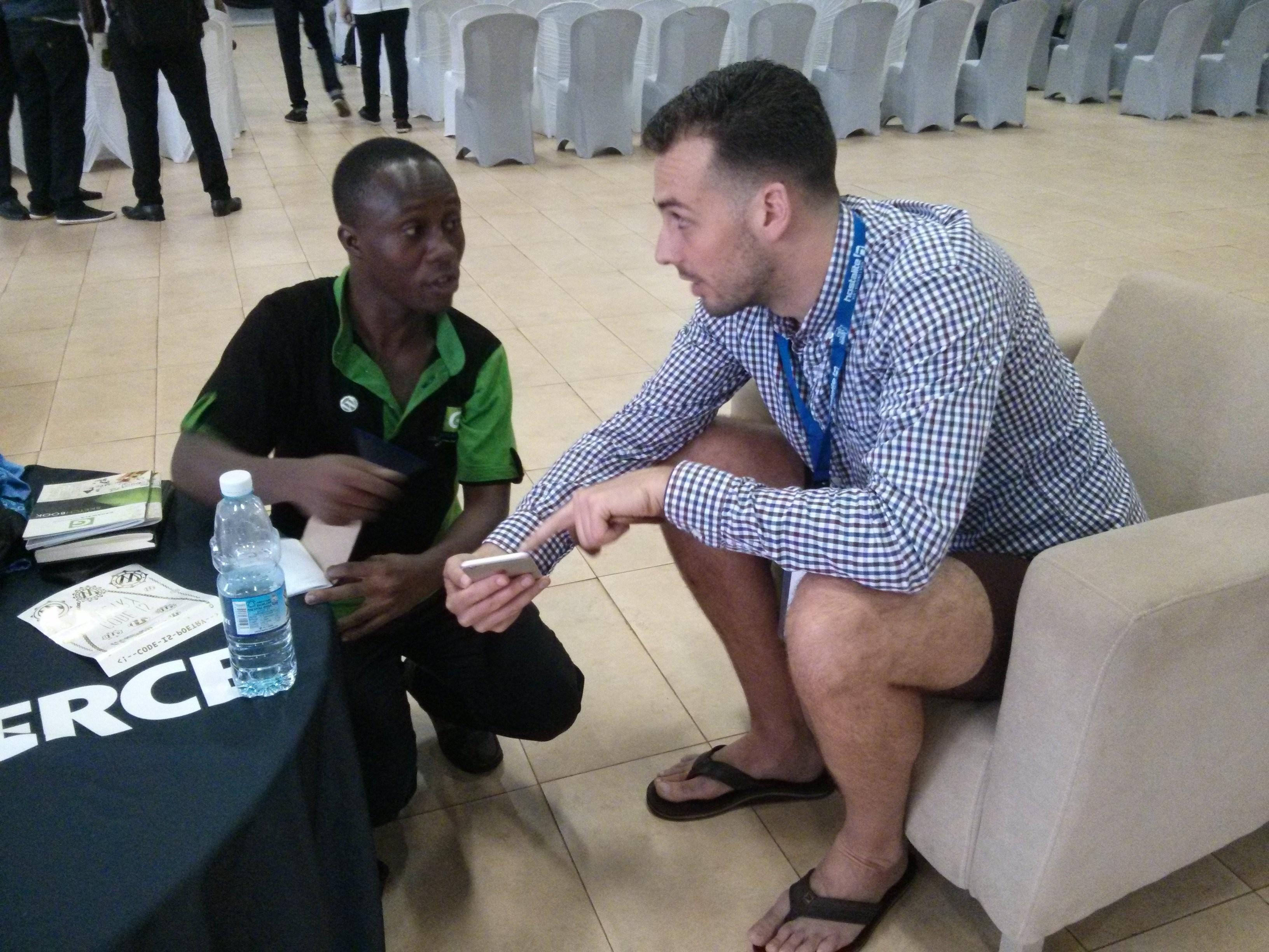 Konstantin and attendee David Wampamba.