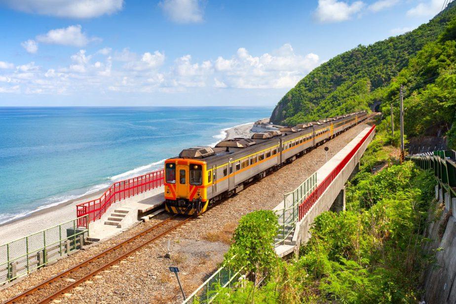 train rail with a beach nearby