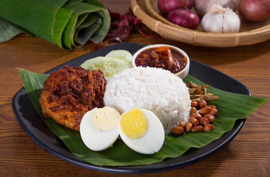 Nasi lemak, a traditional Malay curry paste rice dish served on a banana leaf (image via Shutterstock)
