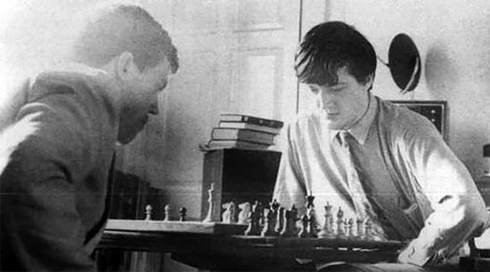 Hugh Laurie and Stephen Fry play chess in Fry's rooms at Cambridge. Chessbase.com photo