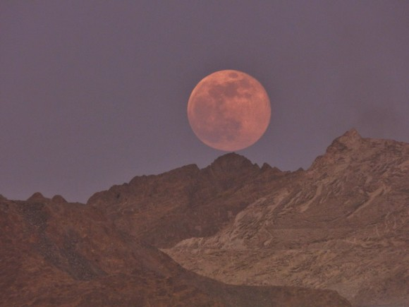 That's how our SuperMoon looked like. In the Sultanate of Oman .. Soft n Delicate against the rugged n craggy mountains of this desert region. Photo credit: Priya Kumar