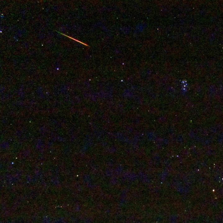 Colorful Perseid meteor in 2013 via Gary P. Caton in North Carolina.  The star cluster on the right is the Pleiades, or Seven Sisters.
