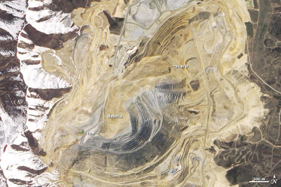 Features of mine obscured by landslide material labeled debris.