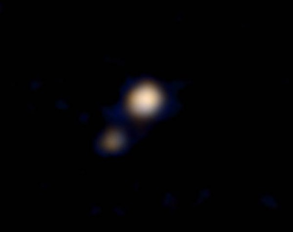 This image of Pluto and its largest moon, Charon, was taken by the Ralph color imager aboard NASA's New Horizons spacecraft on April 9 Credit: NASA/Johns Hopkins University Applied Physics Laboratory/Southwest Research Institute