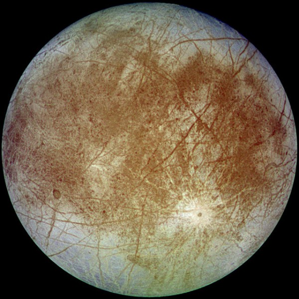 This image shows a view of the trailing hemisphere of Jupiter's ice-covered satellite, Europa, in approximate natural color. Long, dark lines are fractures in the crust, some of which are more than 3,000 kilometers (1,850 miles) long.   Image via Galileo spacecraft in 1996.