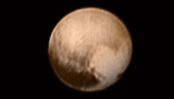 "This image of Pluto from New Horizons' Long Range Reconnaissance Imager (LORRI) was received on July 8. This view is centered roughly on the area that will be seen close-up during New Horizons' July 14 closest approach. This side of Pluto is dominated by three broad regions of varying brightness. Most prominent are an elongated dark feature at the equator, informally known as ""the whale,"" and a large heart-shaped bright area measuring some 1,200 miles (2,000 kilometers) across on the right. Above those features is a polar region that is intermediate in brightness. Image credit: NASA-JHUAPL-SWRI"