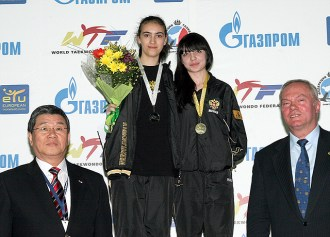 An awarding ceremony for the women's A56 -49kg weight category.