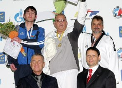 An awarding ceremony for the men's A6 +80kg weight category.