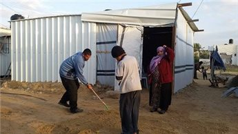 BONES FOUND BENEATH GAZAN MOBILE HOMES FOR DISPLACED
