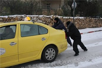 POLICE HELP 450 PEOPLE STUCK IN SNOWSTORM ACROSS WEST BANK