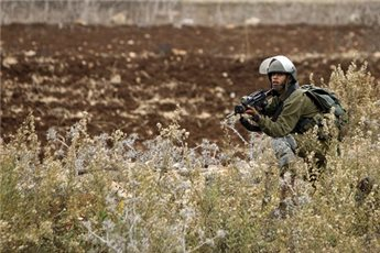 ISRAELI FORCES OPEN FIRE AT PALESTINIANS ACROSS GAZA BORDER
