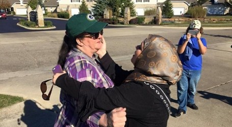 ANTI-ISLAM PROTESTER LEAVES WITH HUG, QUR'AN