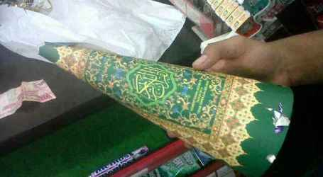 INDONESIAN MINIMARKETS SELLS TRUMPETS OUT OF AL QURAN COVER