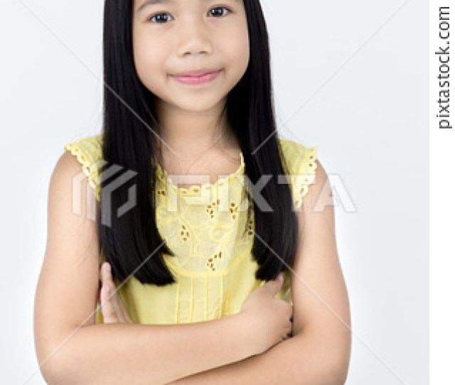 Portrait Of Little Asian Girl With Smiles Face