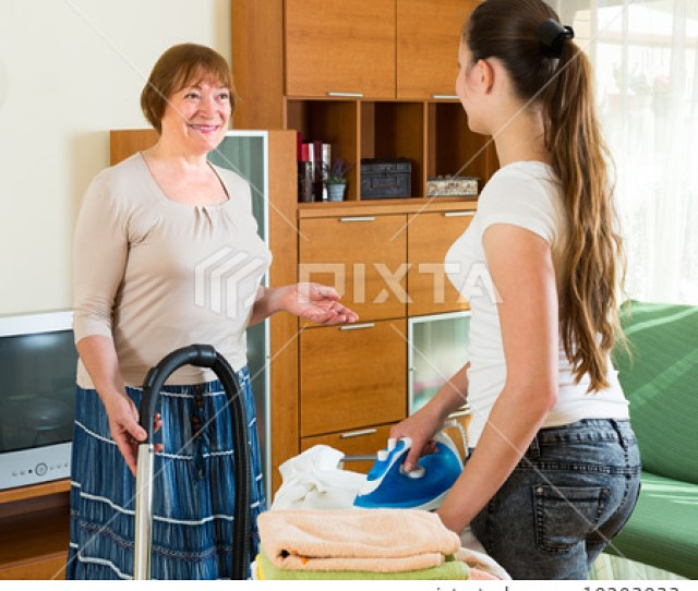 Mature Woman And Girl Cleaning At Home