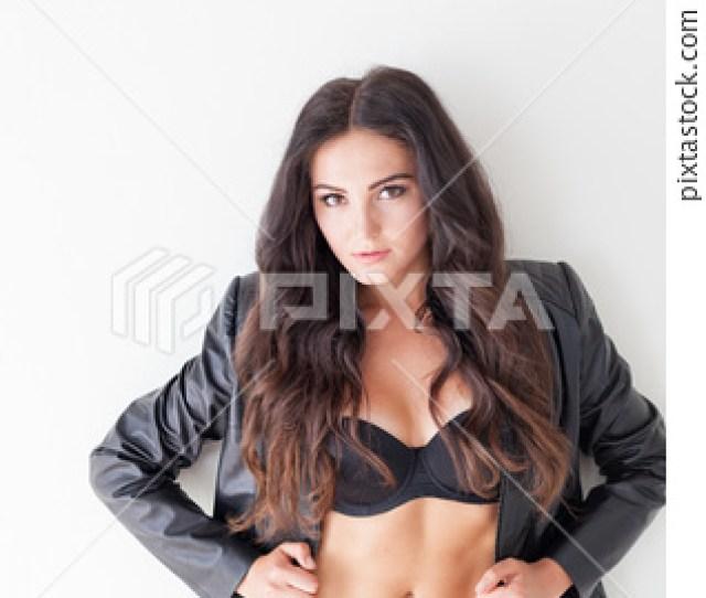 Brunette Girl In Leather Jacket And Black Lingerie