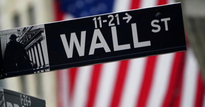 Wall Street closes at record highs as Netflix jumps, Biden inaugurated