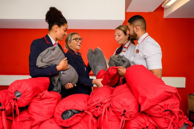 Scarves and blankets made from Virgin Trains staff's worn-out uniforms are being donated to people living on the streets.