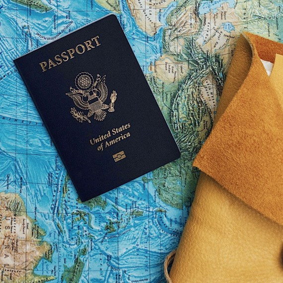 USA passport on a world map