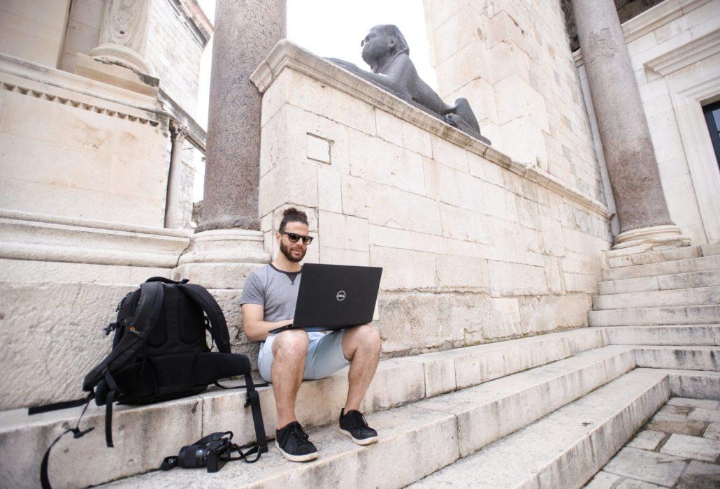 Steve working beneath an Egyptian sphynx statue