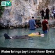 Residents in northern Syria enjoy the fresh cold spring water
